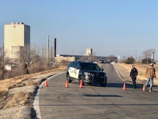 Topeka police late Monday morning continued to block off this area where a man was fatally shot earlier that morning in northwest Topeka during an exchange of gunfire with the Shawnee County Sheriff's Office.