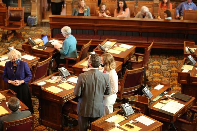 Senate President Ty Masterson, R-Andover, and Senate Minority Leader Dinah Sykes, D-Lenexa, talk Monday on the first day of the 2021 legislative session.