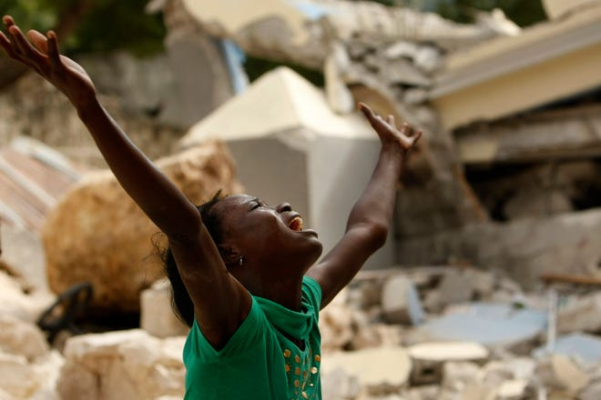 Cindy Terasme screams after seeing the feet of her dead 14-year-old brother Jean Gaelle Dersmorne in the rubble of the collapsed St. Gerard School in Port-au-Prince, Haiti, Jan. 14, 2010, two days after a 7.0-magnitude earthquake hit Haiti on Jan. 12.