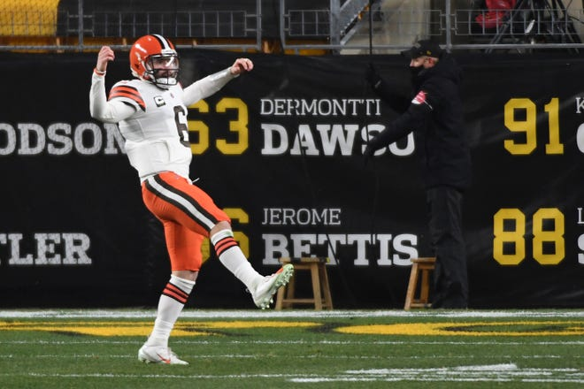 Cleveland quarterback Baker Mayfield reacts after a touchdown in the first half of Sunday's game.