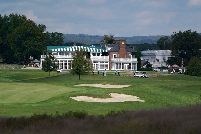 In this Friday, Oct. 2, 2020, photo, golfers play at Trump National Golf Club in Bedminster, N.J. The PGA of America voted Sunday, to not play the 2022 PGA Championship at the club because of the Trump-fueled insurrection at the Capitol on Wednesday.