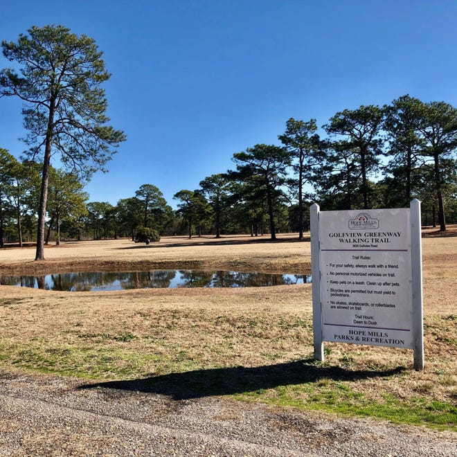 The completion of the driveway and parking lot project includes signage and ADA parking spaces to the 1.6-mile asphalt trail, according to a report by Town Manager Melissa Adams.