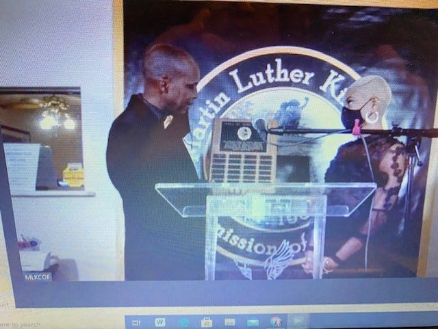 Rodney Long, founder and president of the Martin Luther King Jr. Commission of Florida, inducts Aeriel Lane into the King Commission Hall of Fame.