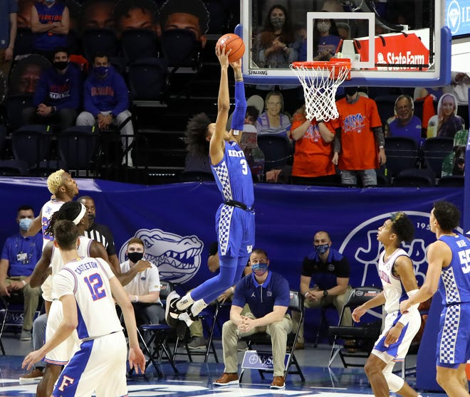 Kentucky guard Brandon Boston Jr. soars in for a slam dunk Saturday against Florida at Exactech Arena. The Gators look to get off the deck against Ole Miss on Tuesday.