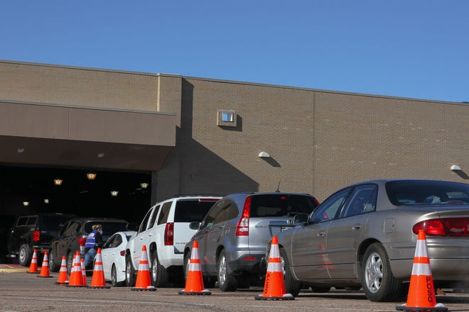 Pueblo Residents wait in line to receive the COVID-19 vaccine.