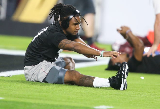 Jan 11, 2021; Miami Gardens, Florida, USA; Alabama wide receiver Jaylen Waddle (17) warms up  before the College Football Playoff National Championship game against Ohio State in Hard Rock Stadium. Mandatory Credit: Gary Cosby-USA TODAY Sports