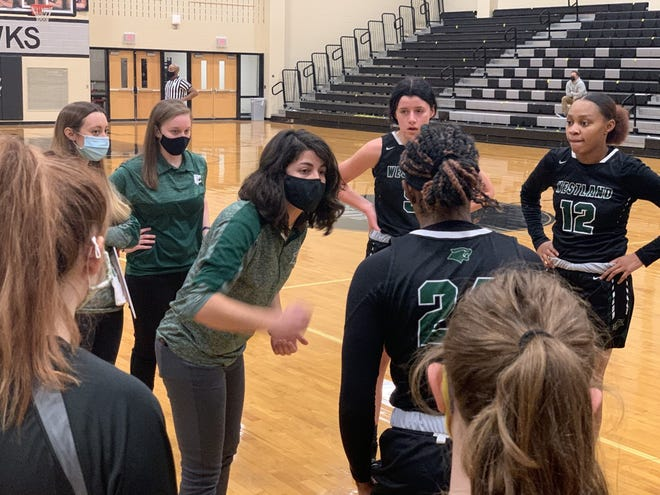 Westland girls basketball coach Nina Napolitano talks to her team during a 54-15 loss at Westerville Central on Jan. 8. Napolitano said the struggling Cougars will continue to work on the fundamentals.