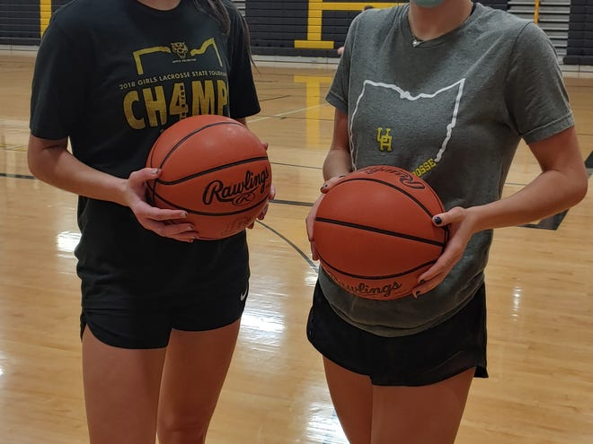 Clara Gallapoo, left, and Annie Hargraves have been key performers for the Upper Arlington girls basketball team both offensively and defensively. Both seniors attribute their defensive prowess to their time playing lacrosse in UA's perennially successful program.