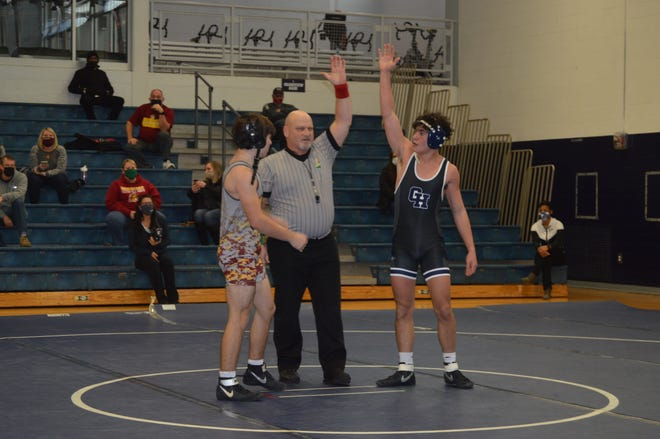 Grandview's Tazio Pintor (right) is declared the winner by official Fred Fuchs after pinning Westerville North's Noah Fett in 49 seconds on Jan. 9. The only other win for Grandview was a pin by Ian Matney, as the Bobcats lost to the Warriors' junior varsity team 56-12.
