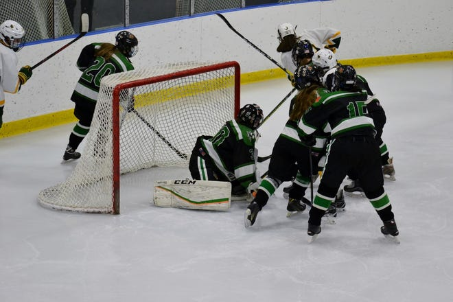The Mansfield/Oliver Ames/Foxboro (MOA) Warriors and King Philip girls' hockey teams tangled for the second consecutive night Jan. 9 in Foxborough with the visiting KP team taking the 3-2 win.