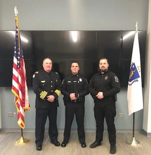 Morgan Billings, center, a recent graduate of the MPTC Plymouth Police Academy and the newest full-time member of the Scituate Police Department, is joined by his father, Rick, who was the Hull Chief of Police before retiring in 2016, and older brother, Taylor, the Scituate Police Traffic Officer.