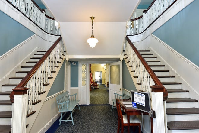 A view of the main level staircase inside the Hamilton Town Hall. [Wicked Local Staff Photo / David Sokol]