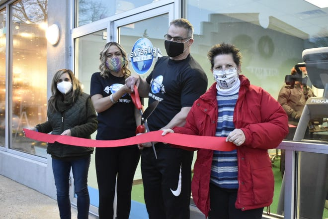 The Wakefield Lynnfield Chamber of Commerce recently held a ribbon-cutting at Enforma Fitness Center in the Greenwood Plaza in Wakefield. Chamber Co-President Janice Casoli, left, and first Vice President Suzanne Bowering, right, were at the event to welcome Enforma Fitness Center co-owners Nadia Tejeda-Colon and Jon Arnold to the chamber.