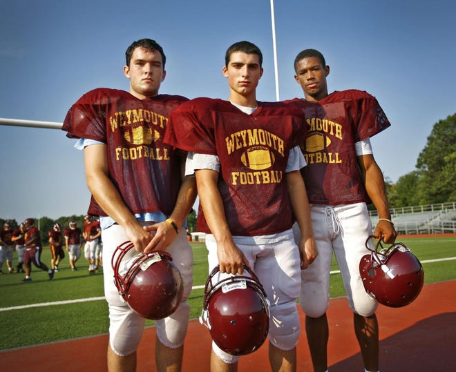 Weymouth HIgh School Wildcats Capt. Cam McLevedge a 2012 graduate, (shown here with team captains John Hachey and Khary Bailey) was named one of the top quarterbacks in a Weymouth Football Memories Facebook page poll.