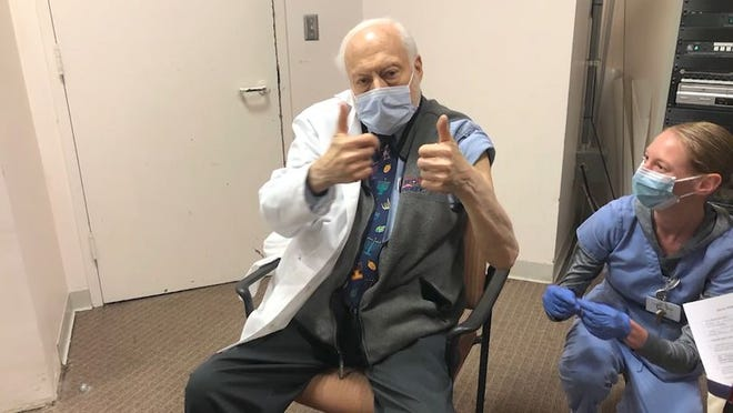 Dr. Alan Ashare, the most senior physician in the Stewart Health Care group and a radiologist at St. Elizabeth's Medical Center, recently received the COVID-19 vaccine. [Courtesy photo / WCVB]
