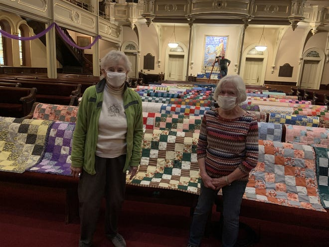 Jean Hill, left, and Ann Cobb display their handiwork inside the United Presbyterian Church of Binghamton. They are members of the church's Sewing Group. Due to the ongoing COVID-19 pandemic, members sew, knit or crochet at home and drop the items off at the church.
