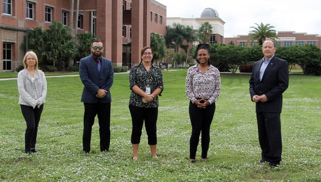 The Winter Haven Hospital Foundation and Florida Tech have launched a new training program. Key participants include, from left, College of Psychology and Liberal Arts Dean Lisa Steelman, assistant professor of clinical psychology Patrick Aragon, students Shelby Gregson and Tenasia Wynn, and Joel Thomas, president of the Winter Haven Hospital Foundation.