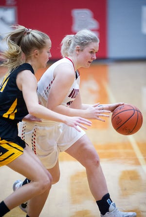 Buckeye Central's Kyleigh Brown dribbles around Colonel Crawford's Ally Hocker.