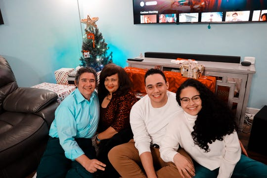 The Tuero family on Christmas eve 2020. Saulio sits on the left and Sam in the middle.