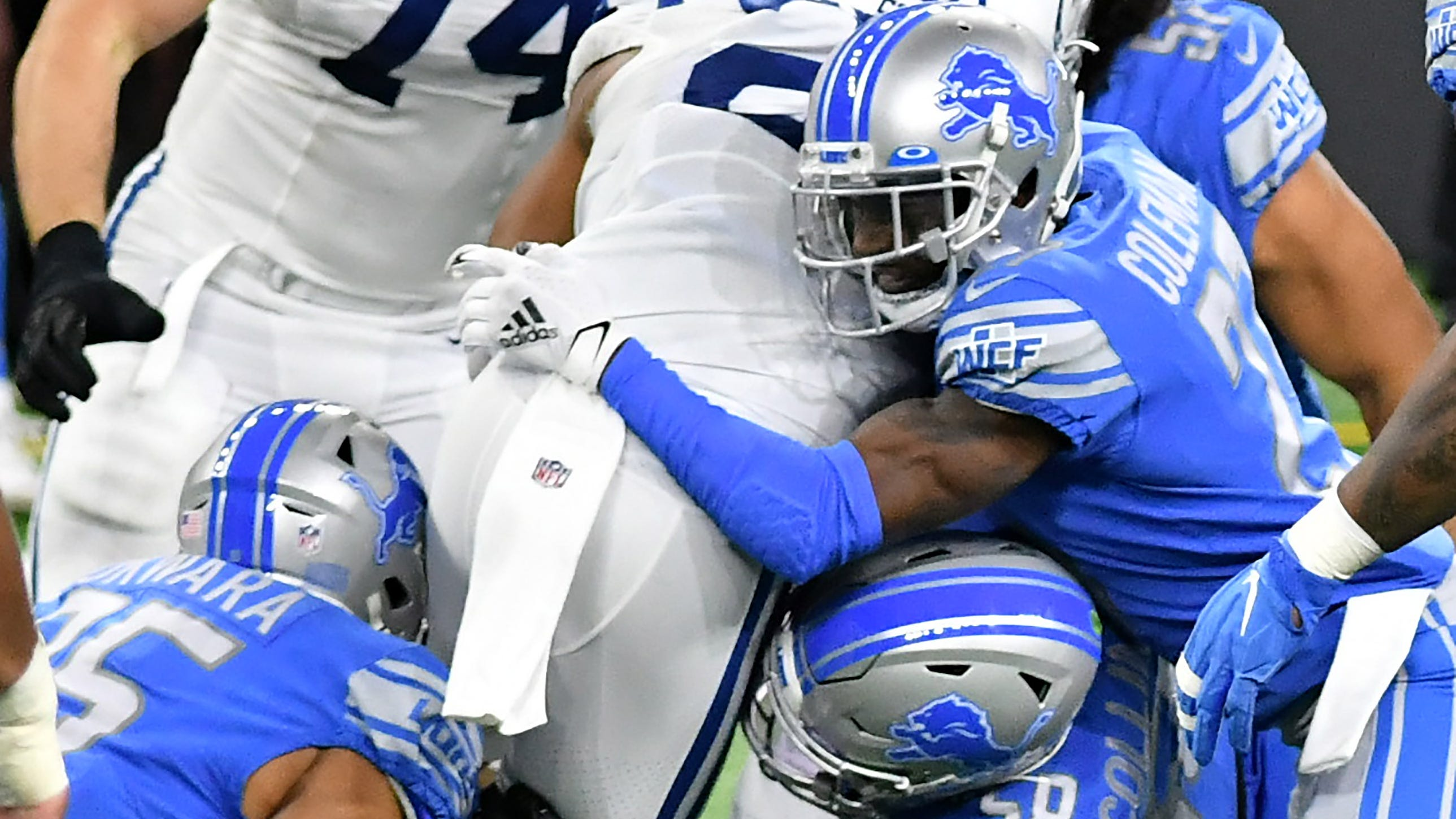 The Lions' Romeo Okwara (95), Jamie Collins Sr. (58) and Justin Coleman tackle Colts running back Jonathan Taylor in the first half of a game in November.