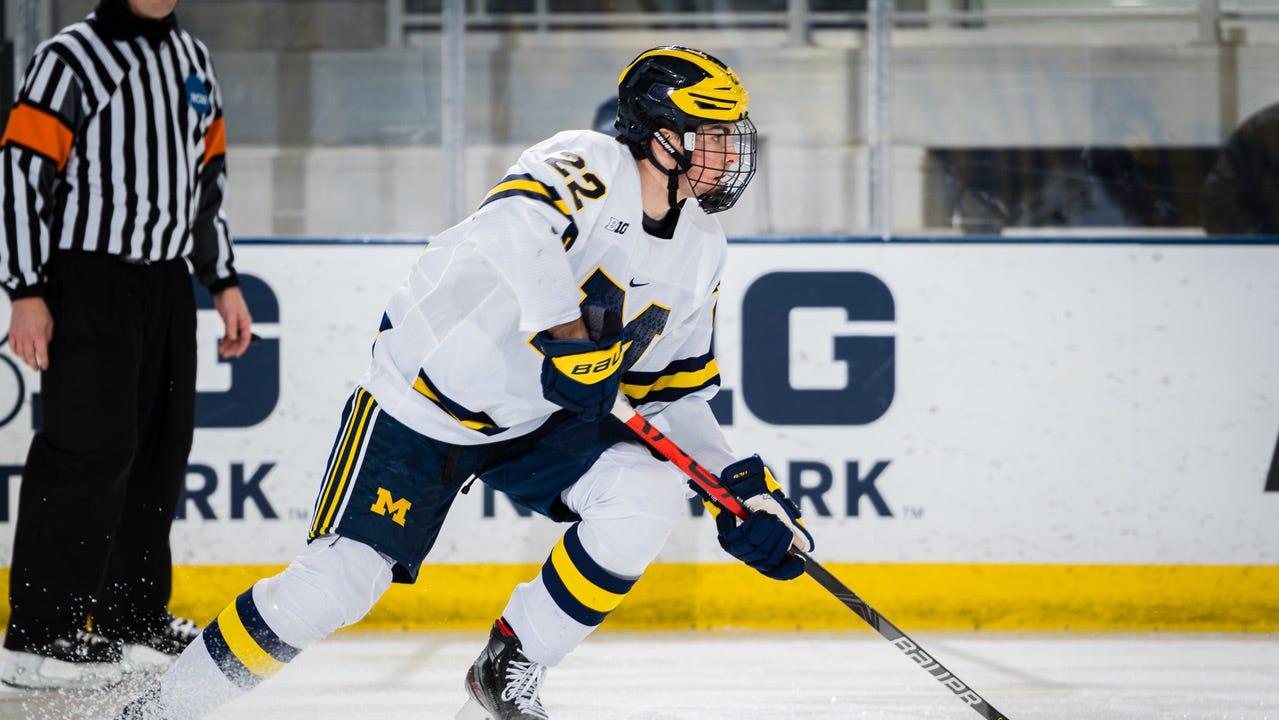 Wolverines defenseman Owen Power carries the puck during a 9-0 win over the Spartans at York Arena on Friday.