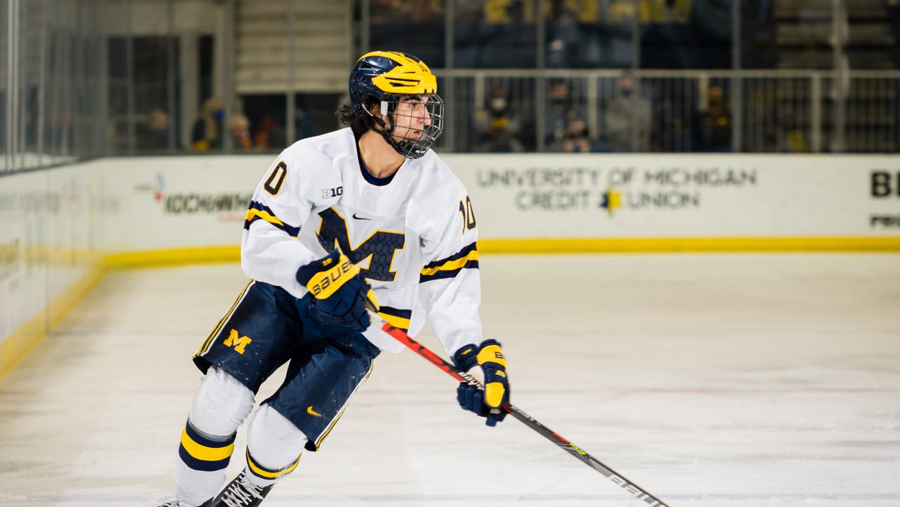 Wolverines forward Matty Beniers carries the puck during Friday'ss 9-0 win over the Spartans at Yost Arena in Ann Arbor.