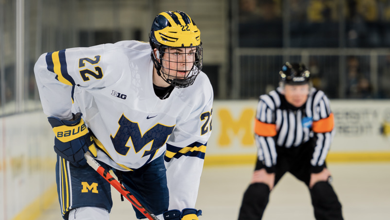 Wolverines defenseman Owen Power lines up for a faceoff during a 9-0 win over the Spartans at York Arena on Friday.
