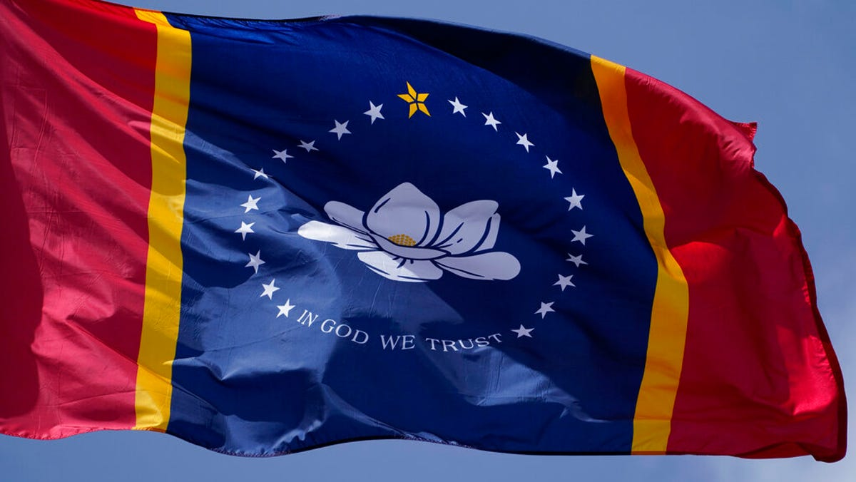 Mississippi governor signs law for flag without rebel sign 1