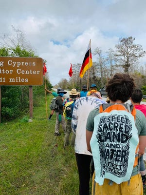 About 50 people trekked through the Everglades on the #DefendTheSacred prayer walk earlier this month.
