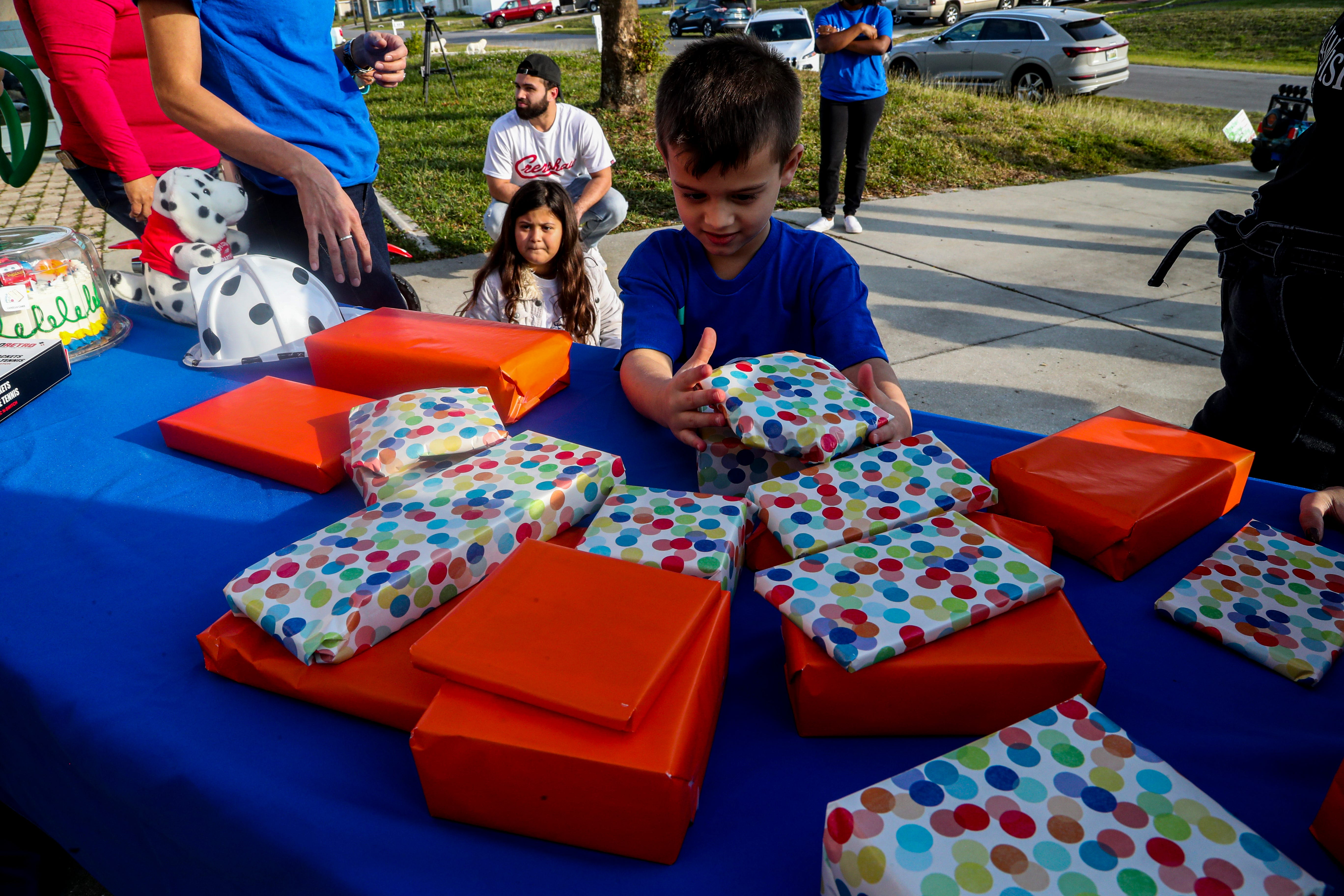 Cancer-stricken Cape Coral boy's wish granted at front door — toys, fire truck and police cars 1