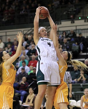 UWGB guard Caitlyn Hibner (4) is averaging 15.7 points and 7.7 rebounds as a senior this season.