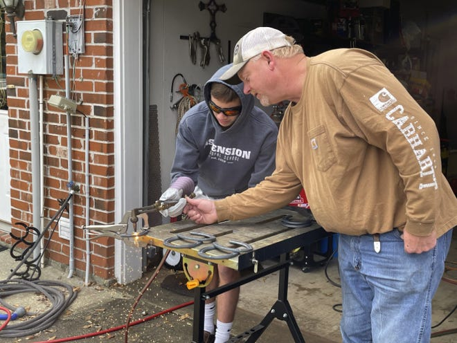 Students in Ascension Episcopal School Upper School's Makerspace elective class were challenged to come up with an original design and bring it to life for their final project. Here, Cole works with his uncle on his welding art project.