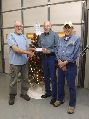 The Northeast Lakeside Fire Department Auxiliary recently presented the department with a $10,000 check. Shown above are, from left, fire chief Henry Porter; auxiliary president Hart Rowland; and auxiliary treasurer Tom Telford.