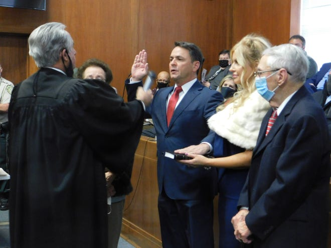 New St. Landry Parish District Attorney Chad Pitre, second from left, is sworn in Monday, Jan. 11, 2021, by Louisiana Supreme Court Justice Jimmy Genovese. With Pitre are his parents, Donald and Joy Pitre, and his fiancée, Brenda King.