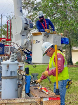 Gulf Power line worker, Jeremy Davey, restores power to customers homes and businesses that lost power due to Hurricane Zeta in Pensacola, FL on Oct. 29, 2020