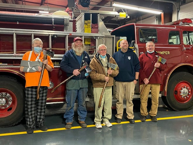 Put-in-Bay firefighters who were recognized in December for serving 50 years or more are Mark Wilhelm (left), 50 years; David Bianchi, 50 years; Allen Duff, 57 years; Greg Dobos, 50 years; and Chief Chris Ladd, 50 years.