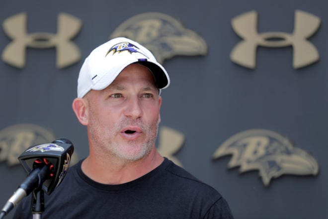 Baltimore Ravens quarterbacks coach James Urban talks to reporters during NFL football training camp, Friday, July 26, 2019, in Owings Mills, Md. (AP Photo/Julio Cortez)