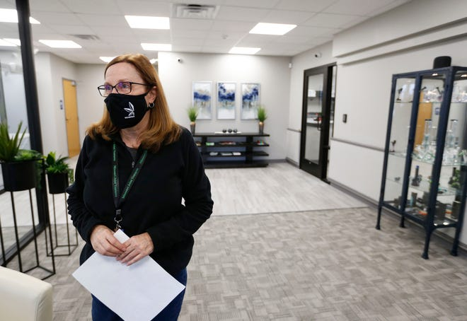 Dana Sullinger, a credentialed pharmacist who owns Missouri Joint Ventures dispensary with her family, talks about the new dispensary in Christian County on Monday, Jan. 11, 2021.