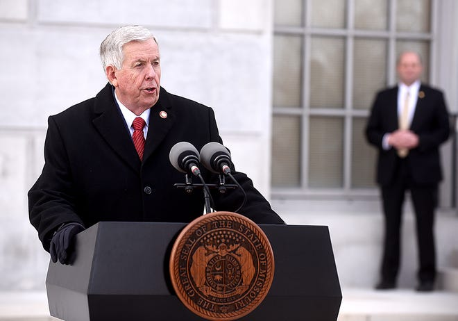 Gov. Mike Parson speaks to reporters Monday in front of the north portico of the Missouri Capitol Building following his inauguration.