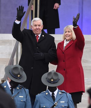 Gov. Mike Parson and his wife Teresa wave to the crowd as they are announced Monday before Gov. Parson was sworn in as the 57th Governor of Missouri by Missouri Supreme Court Judge Mary Russell on the steps of the Missouri Capitol Building. [Don Shrubshell/Tribune]
