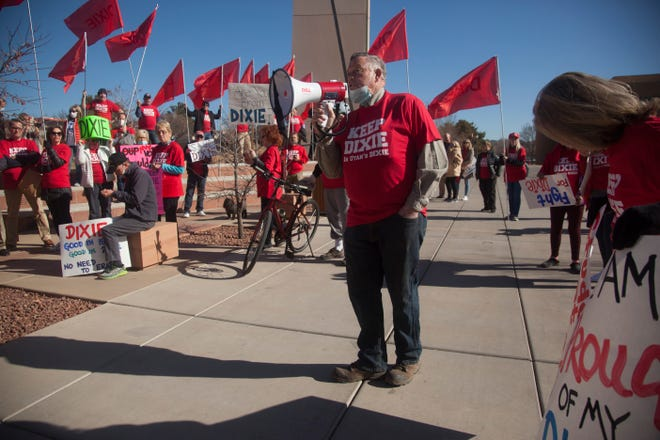 "Former St. George Mayor Dan McArthur speaks to a crowd gathered at Dixie State University on Monday, Jan. 11, 2021. The group marched onto campus carrying flags and wearing red, protesting a proposal by university leadership to drop the word ""Dixie"" from the school's name."
