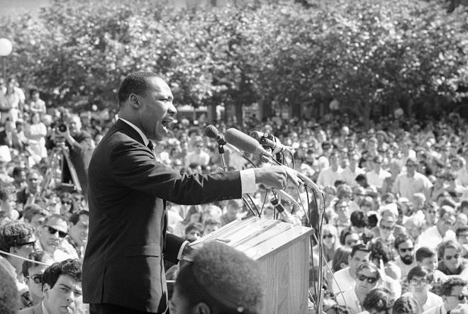 A large portion of the estimated 5,000 who listened intently to Dr. Martin Luther King, arrow, lower right, from Sproul Hall, University of California administration building in Berkeley, California, May 17, 1967. Dr. King reiterated his stand for non-violence and urged that young people support a peace bloc that would influence the 1968 elections.