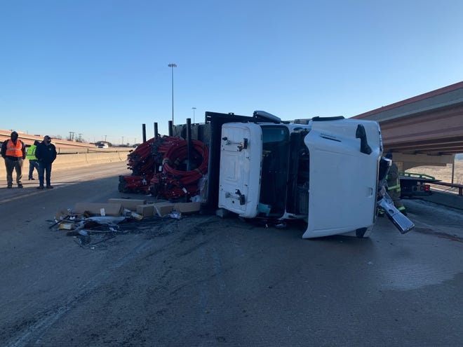 An 18-wheeler is on its side on eastbound Texas 45 in Round Rock. Officials say the truck has spilled diesel onto the highway.