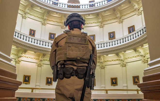 Texas Department of Public Safety troopers protect the second floor of the Capitol on Tuesday, the first day of the 87th Legislature.