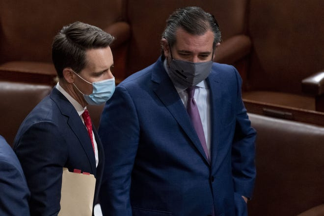 Sen. Josh Hawley, R-Mo., left, and Sen. Ted Cruz, R-Texas, right, speak Jan. 6 after Republicans objected to certifying the Electoral College votes from Arizona.