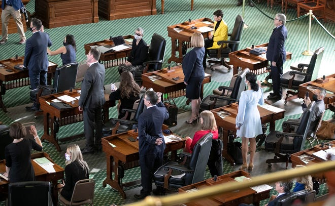 State senators are sworn in at the Capitol on the first day of the 87th Legislature on Tuesday January 12, 2021.