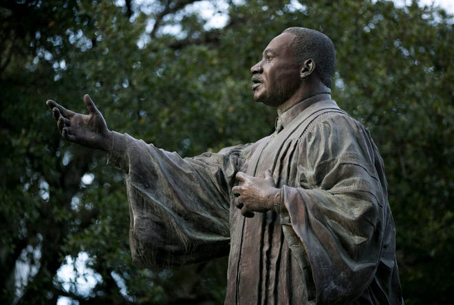 A statue of Dr. Martin Luther King  Jr. towers over the MLK March and Festival at the University of Texas in 2019. Dr. King's vision has been misplaced, a reader writes. [JAY JANNER/AMERICAN-STATESMAN]