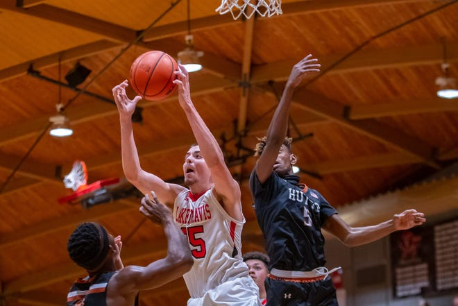 Miguel Mantilla, left, battling for a rebound early in the season against Hutto, helped Lake Travis win both of its district games last season and improve to 3-0 in District 26-6A play entering this week.