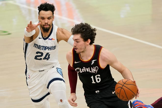 Cavaliers' Cedi Osman (16) drives past Memphis Grizzlies' Dillon Brooks (24) in the second half of an NBA basketball game, Monday, Jan. 11, 2021, in Cleveland. [Tony Dejak/Associated Press]