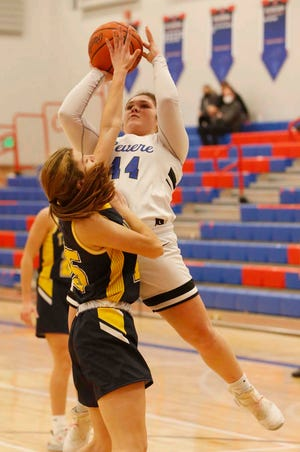 Emma Drushell, right, of Revere, attempts to go up for two points over Isabella Messina of Tallmadge during the second half of their game Monday, Jan. 11, 2021 in Richfield, Ohio. [Karen Schiely/Beacon Journal]
